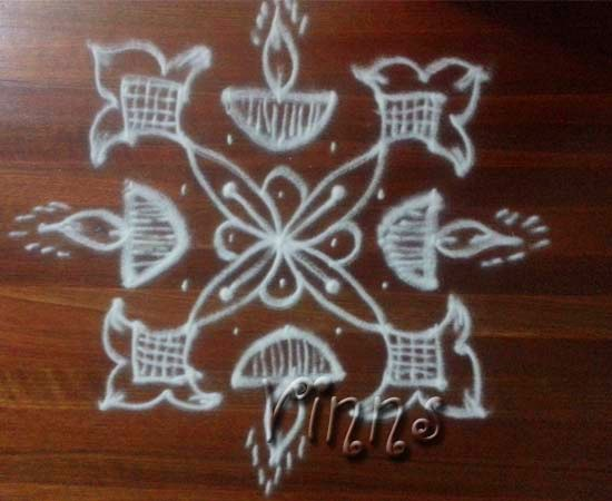5 Pulli kolam with vilakku design